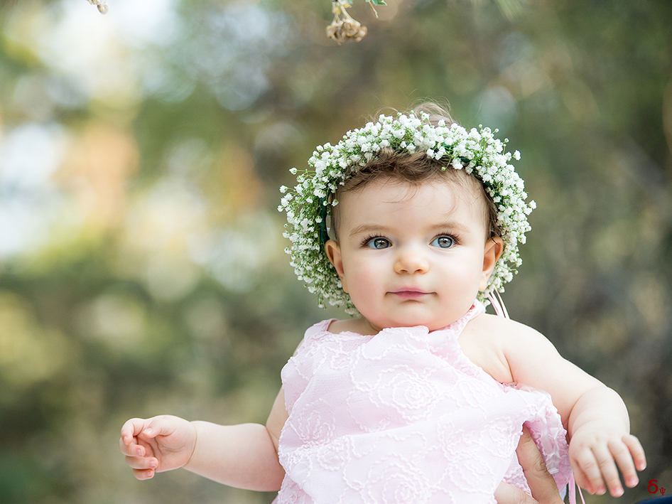 girls portrait on the christrening day pink dress and flowers baptism day
