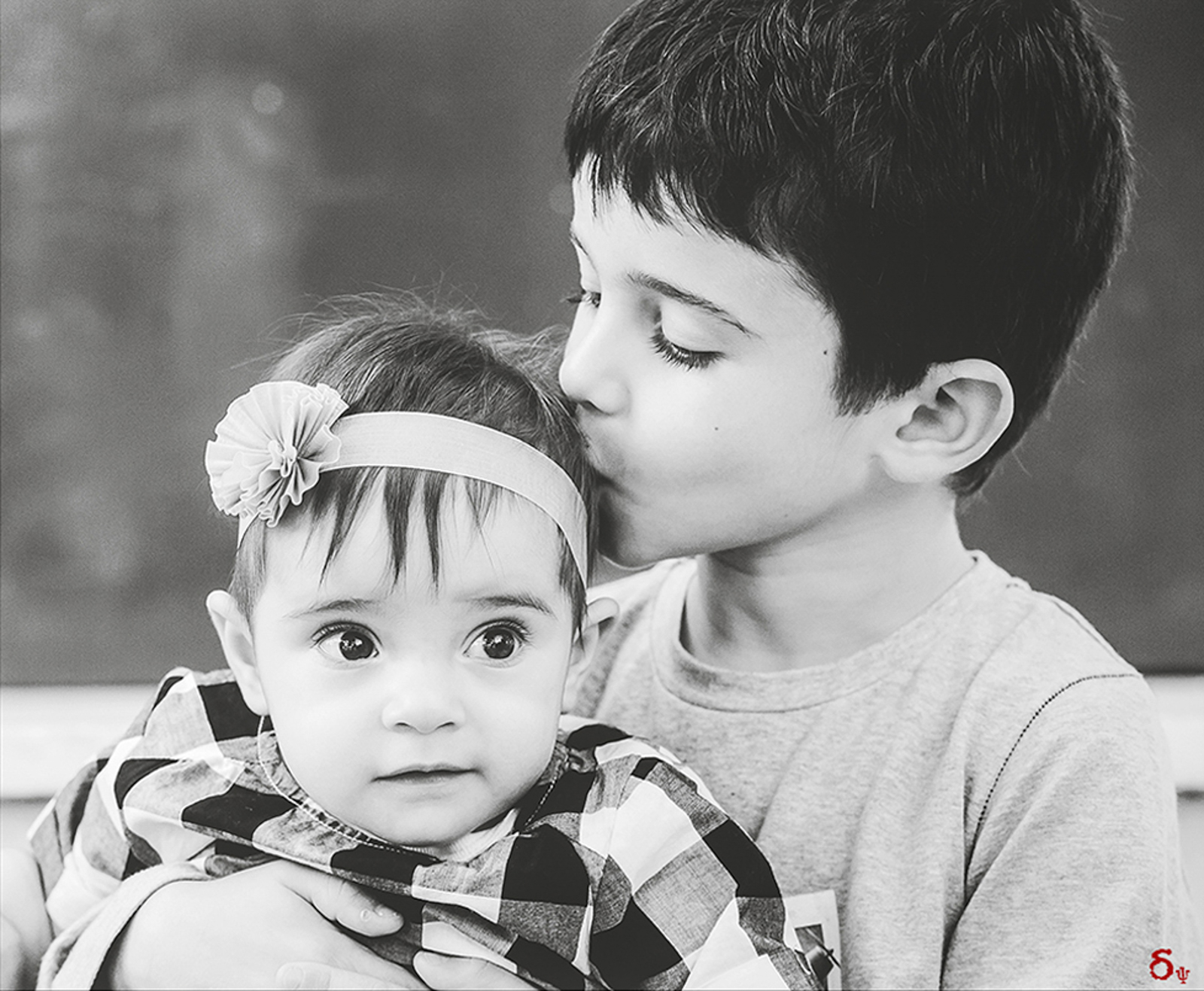 brother and sister love kiss hug christening day  family portraits baby portraiture black and white