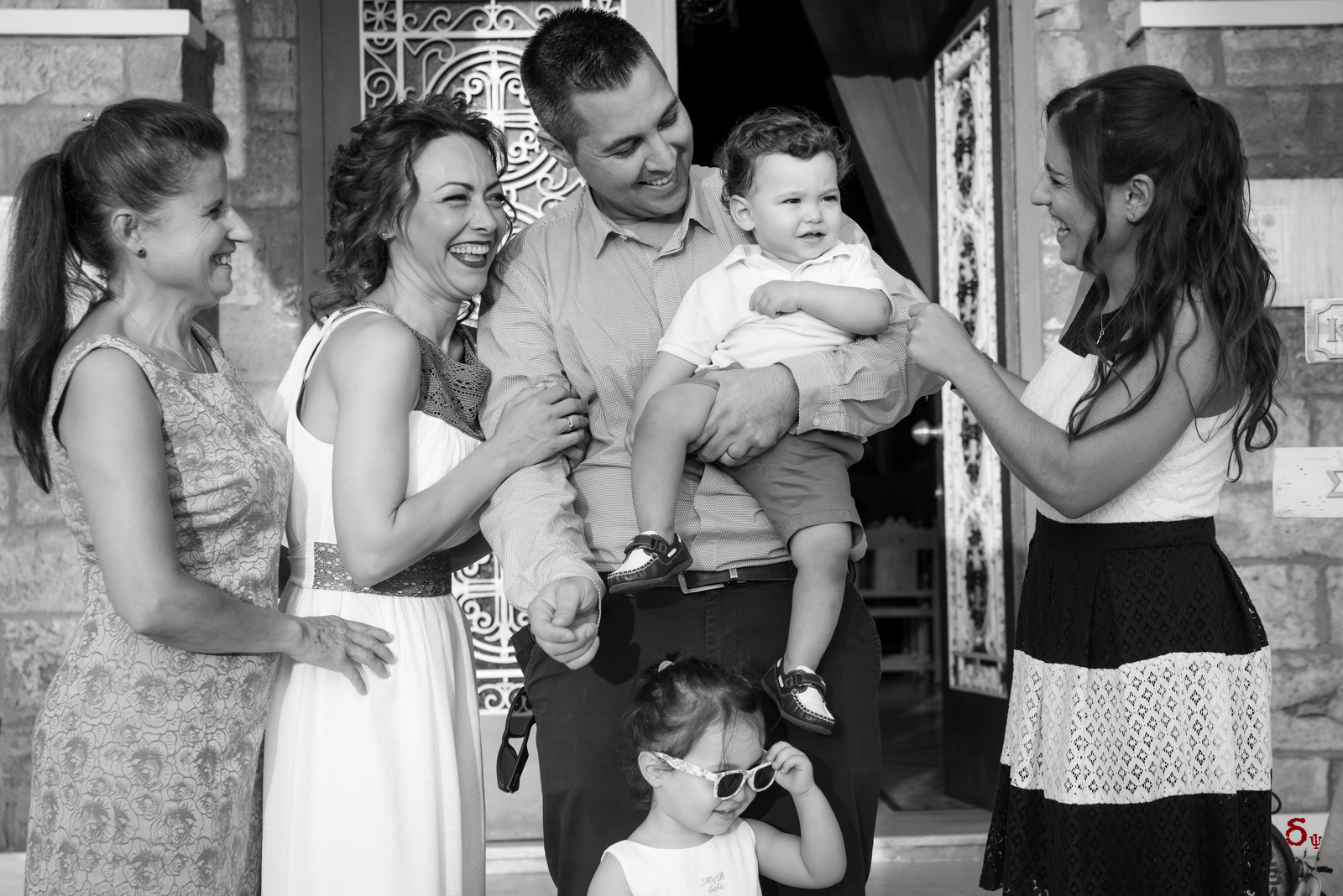 hugs and love family christening photoshooting black and white showered with support and joy by family and friends special christening day bw